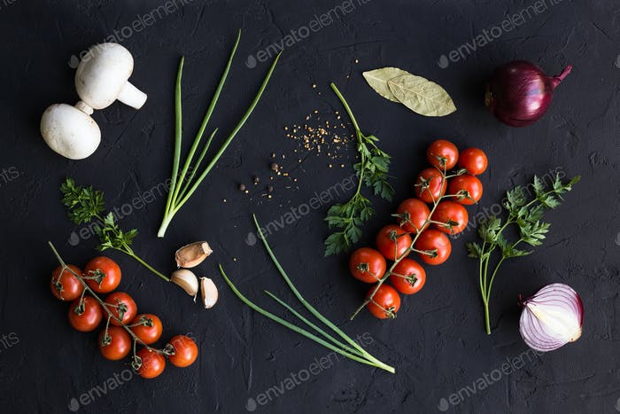 Fresh ingredients for cooking pasta, tomatoes, onions, garlic, herbs, mushrooms and spices