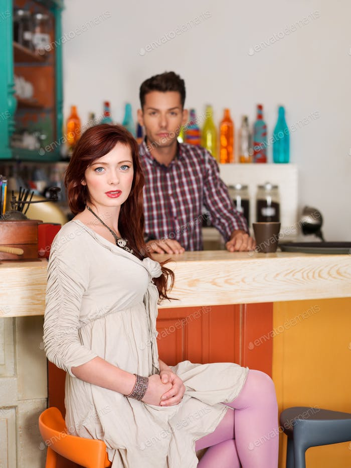 beautiful red haired girl in a bar