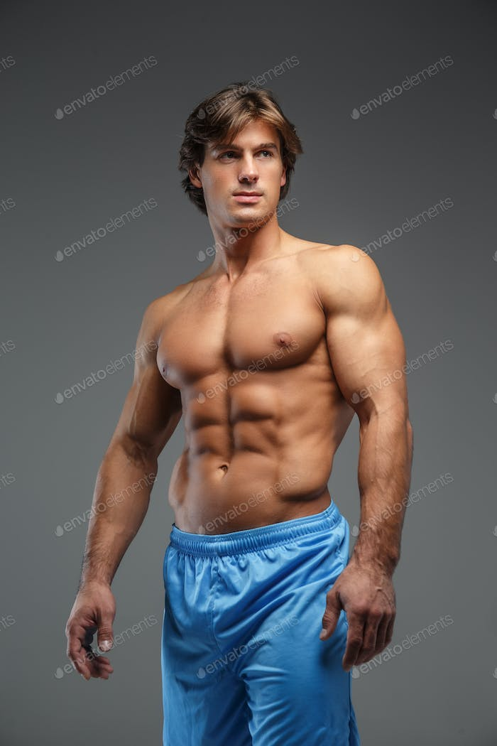 Awesome shirtless bodybuilder in blue shorts.