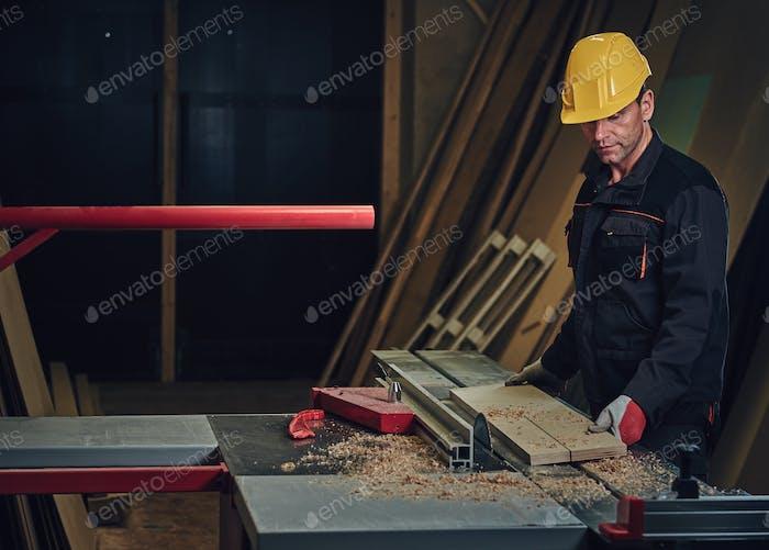 Carpenter male in a work place.