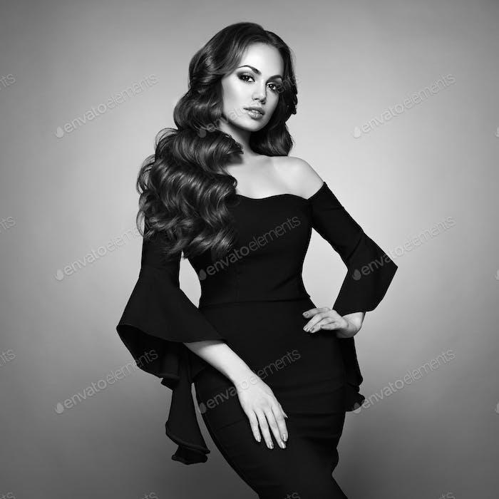 Beautiful woman in elegant black evening dress
