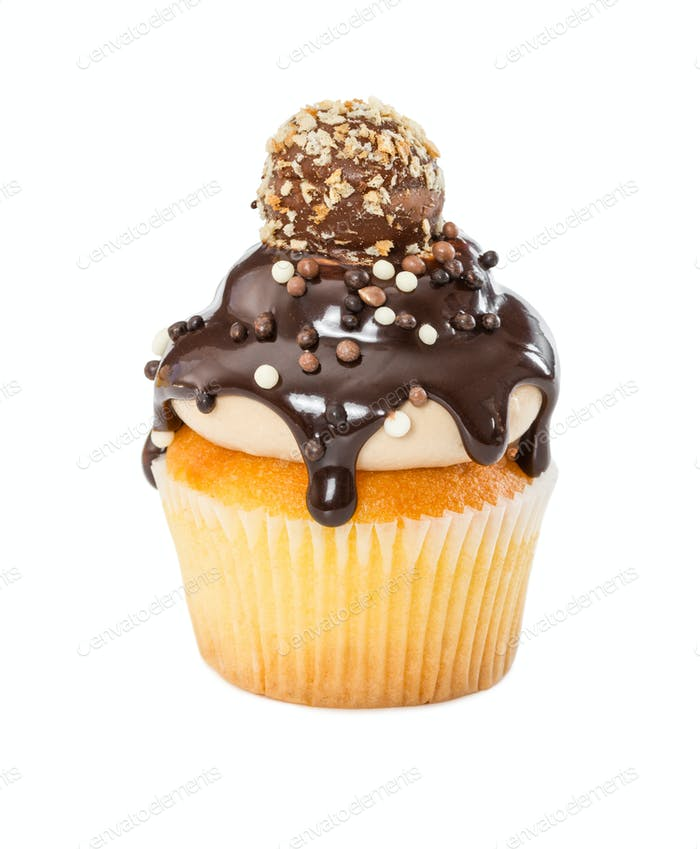 Cupcake with chocolate syrup, sprinkles and candy isolated on wh