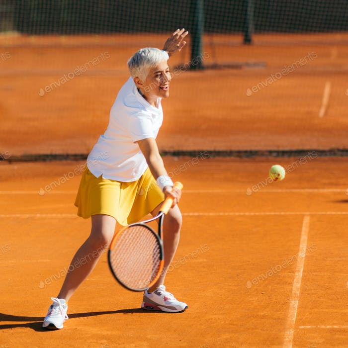 Beautiful Mature Woman at the Tennis Court