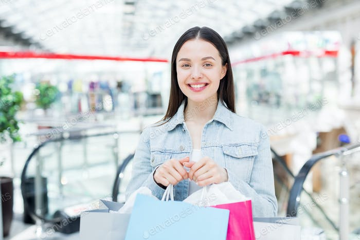 Happy shopaholic in large mall