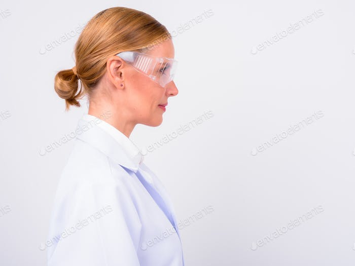 Profile view of blonde woman doctor as scientist