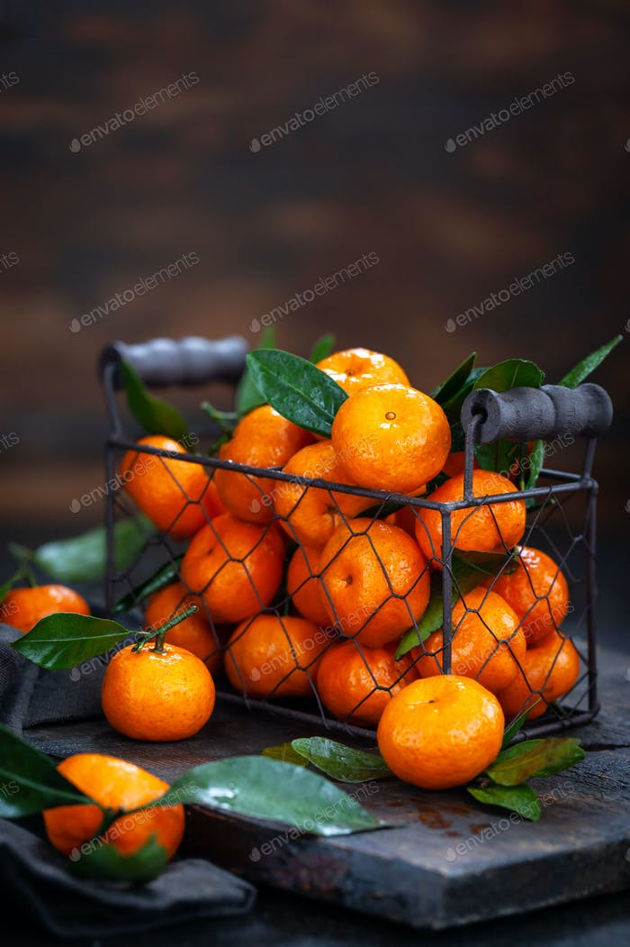 Fresh ripe tangerines with leaves
