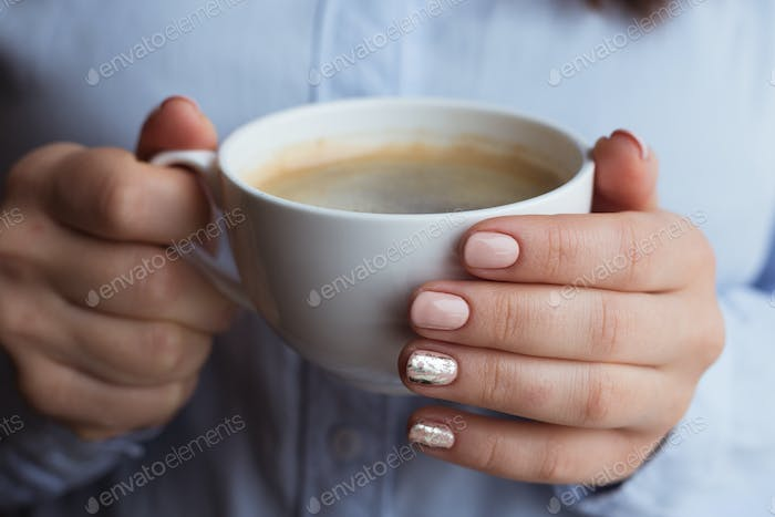 Female hands with coffee drink