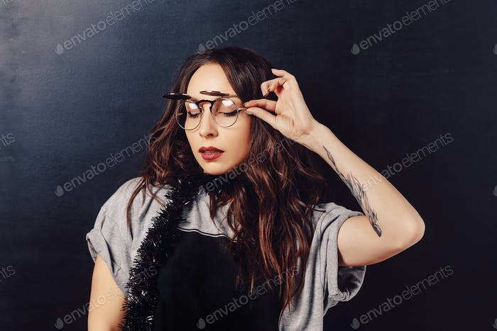 Portrait of seductive hipster girl wearing glasses