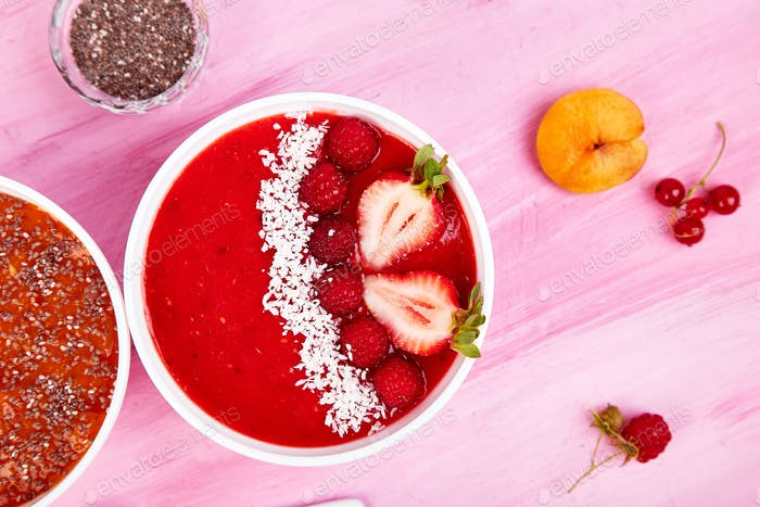 Smoothie bowls. Healthy breakfast bowl on pink background