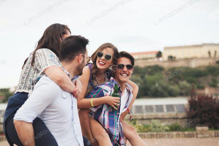 Happy group of friends enjoying festival