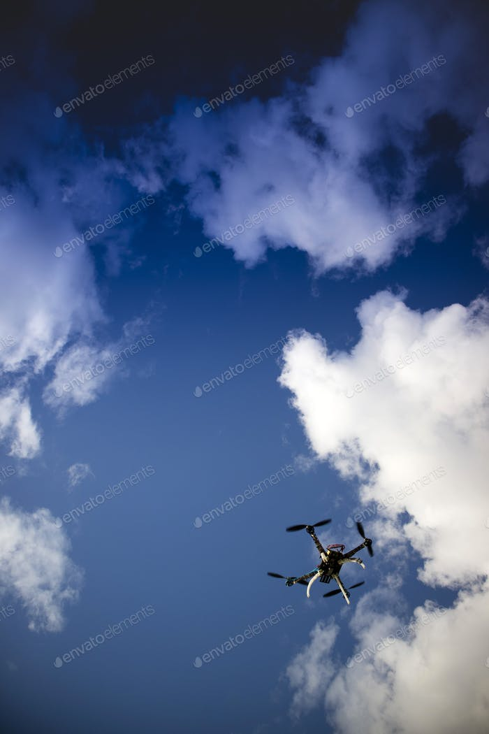 Drone in flight with cloudy sky
