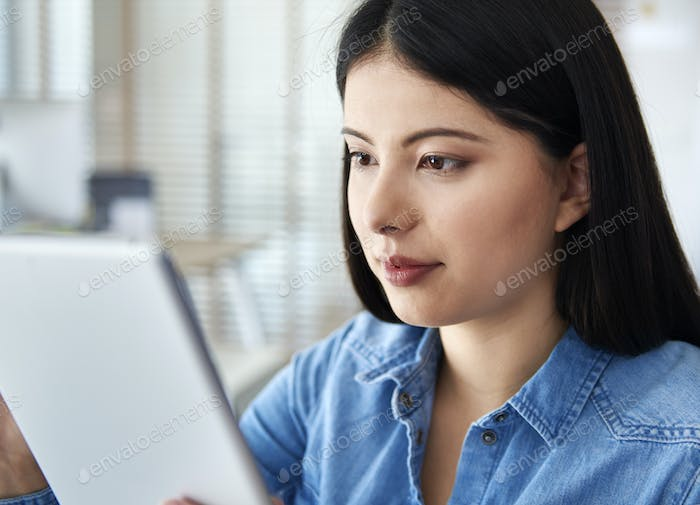 Real close up of woman with a digital tablet