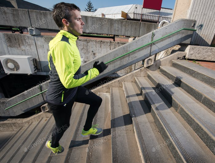 man jogging on steps