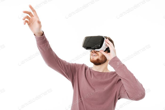 Cool boy happily playing with visual reality glasses isolated