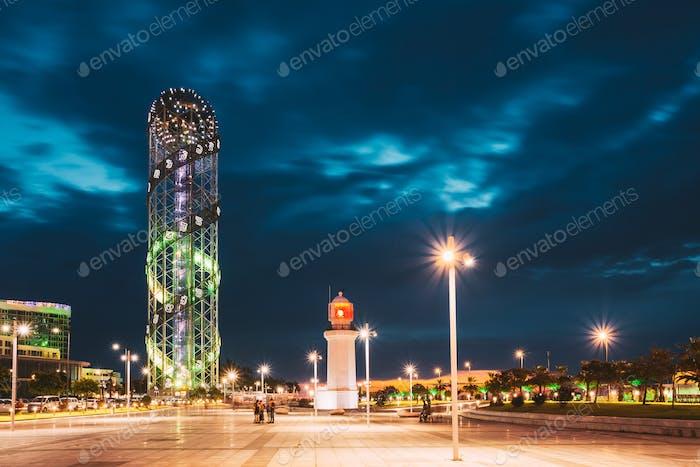 Batumi, Adjara, Georgia. Illuminated Alphabet Tower And Lighthouse At Promenade Near Miracle Park