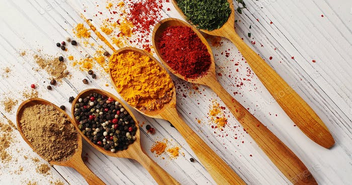 Creative layout of spoons with spices
