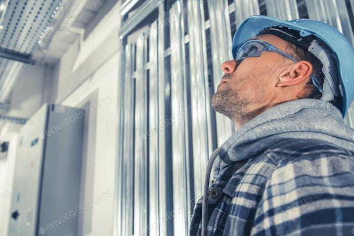 Caucasian Construction Engineer in Blue Hard Hat