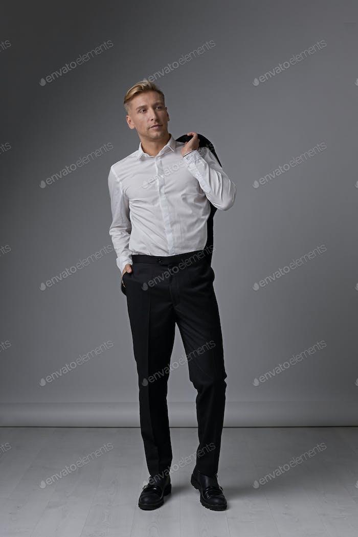Confident businessman portrait posing relaxed