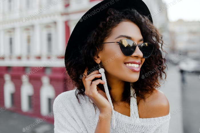 Sensual african lady in trendy  outfit enjoying good day