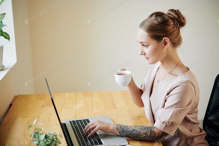 Woman reading news online