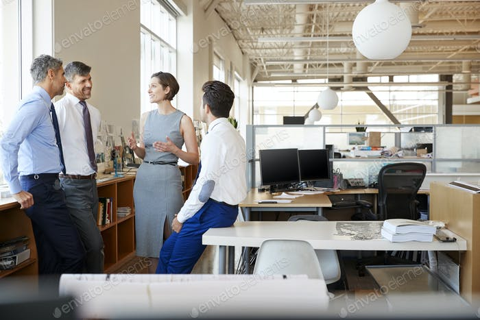 Female manager in discussion with colleagues at work