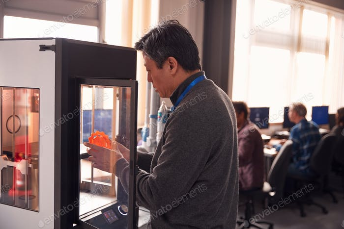 Mature Male College Student Studying Engineering Using 3D Printing Machine