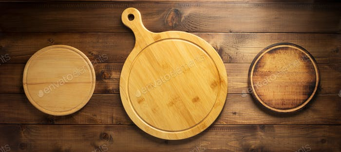 pizza or bread cutting board at wood