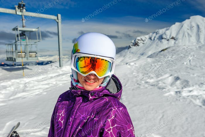 Young woman in ski goggles outdoors