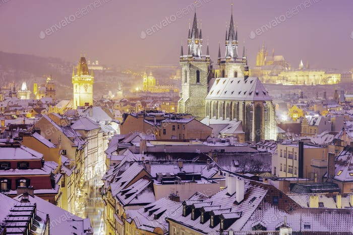 Winter in Prague - city panorama with Tyn Cathedral and Clock To