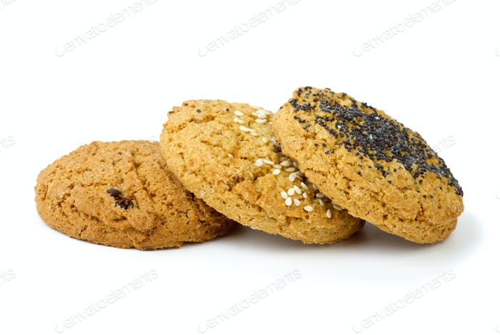 Three oatmeal cookies isolated on the white background