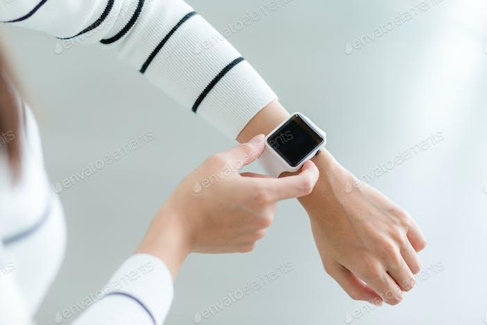 Woman using smartwatch