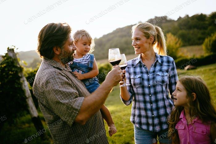 Wine grower family in vineyard