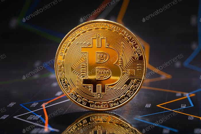Gold bitcoin standing on financial graphs for cryptocurrency prices
