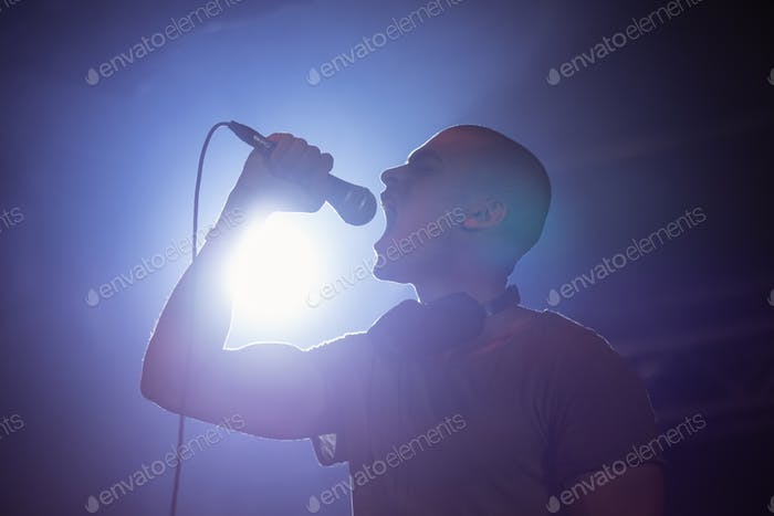 Cheerful male singer performing at nightclub
