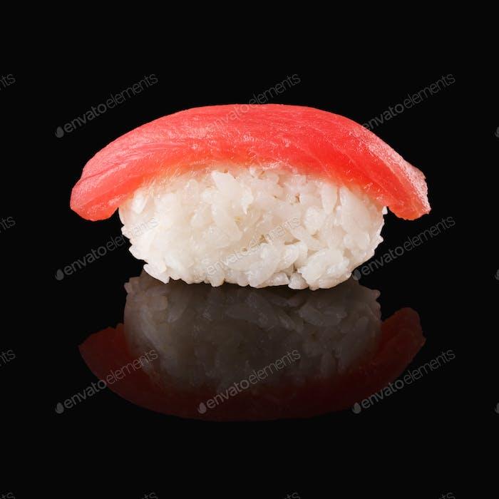 Tuna sushi on black mirroring background