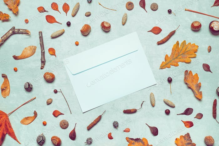 Blank post mail envelope mock up with autumn arrangement
