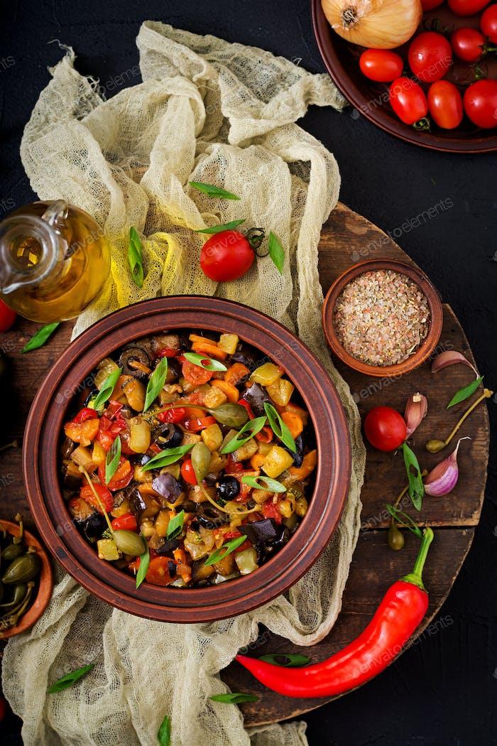 Hot spicy stew (caponata) eggplant, zucchini, sweet pepper, tomato