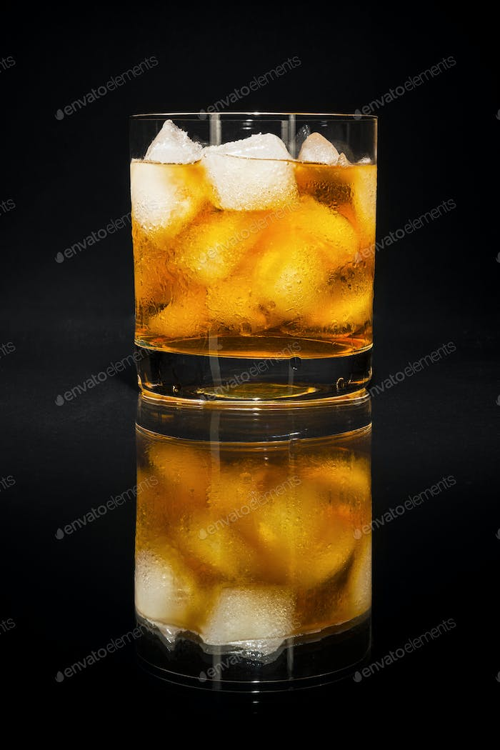Old fashioned cognac glass on the black background