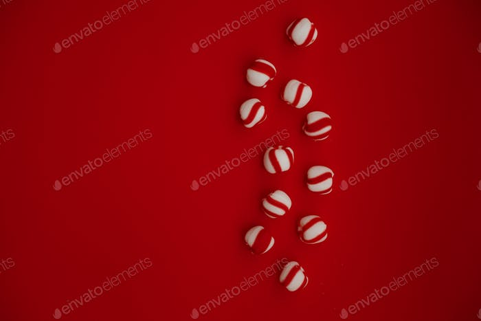 Christmas flatlay peppermint candies on red background