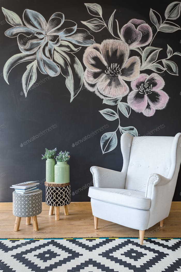 Room with chair and chalkboard