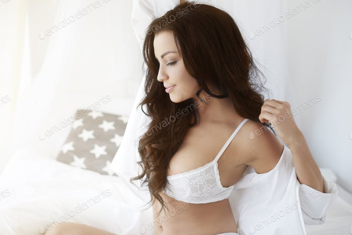 Well rested woman in the bed