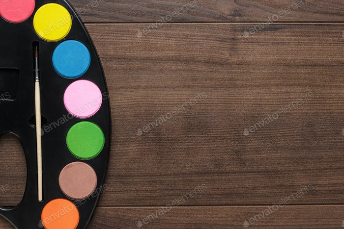 Watercolors On The Wooden Table