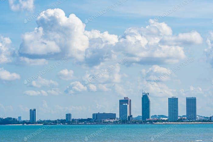 Beautiful landscape of sea with Pattaya cityscape and white clou