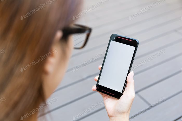 Woman use of the mobile phone with blank screen
