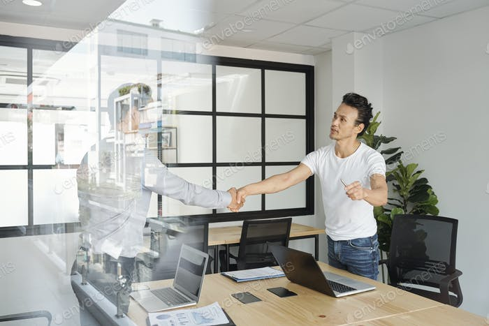 Project manager shaking hand of coworker