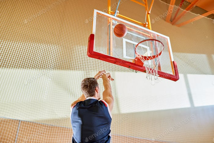 Anonymous basketball player throwing ball