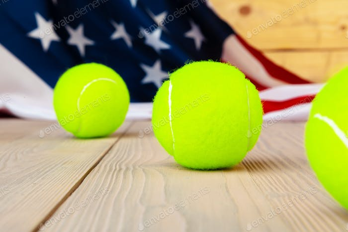 Tennis equipment on wooden surface close up