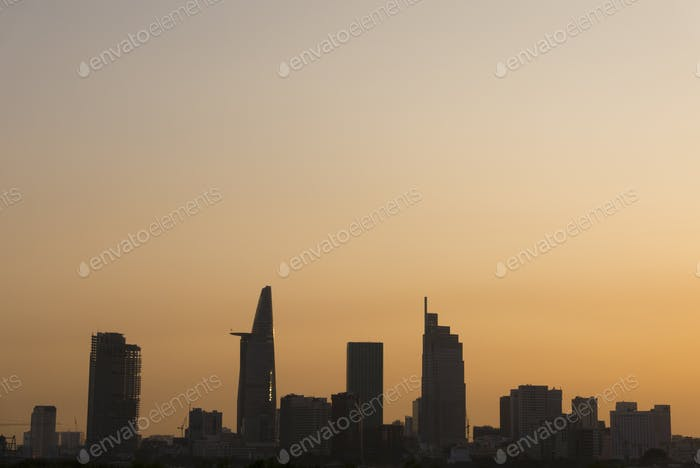 Sunset in Saigon with tower silhouette, Vietnam