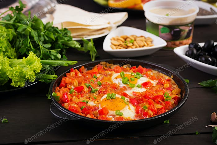 Turkish Breakfast -  shakshuka, olives, cheese and fruit. Rich brunch.