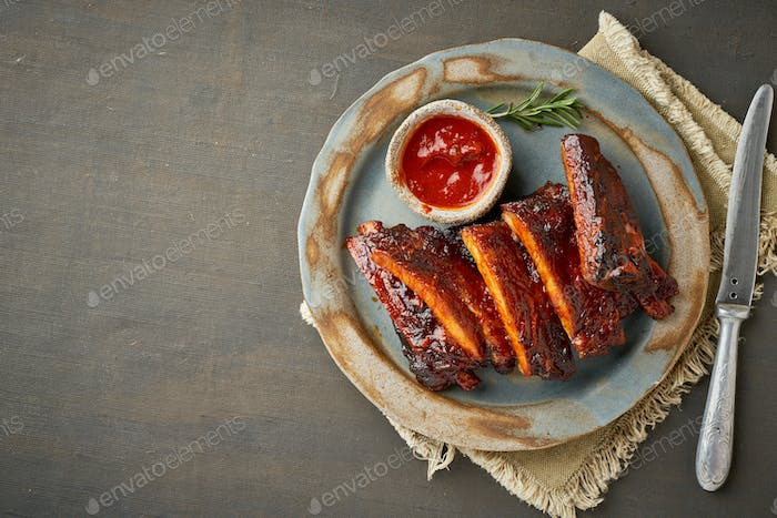 Keto food, spicy barbecue pork ribs. Top view, copy space